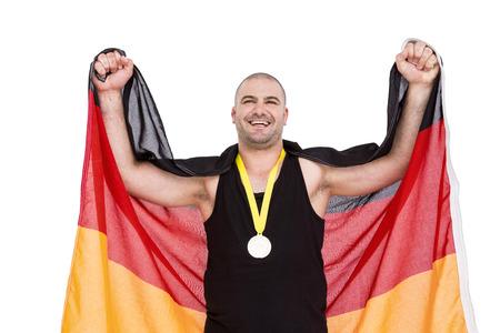 bandera alemania: Atleta con una medalla de oro con el indicador de Alemania en el fondo blanco