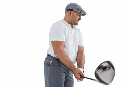 cut the competition: Golf player taking a shot on white background Stock Photo