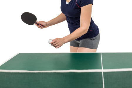 cut the competition: Female athlete playing table tennis on white background