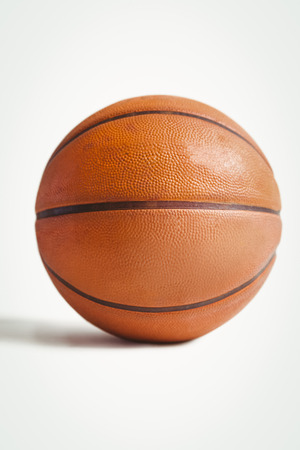 athleticism: Close up of basket ball on white background
