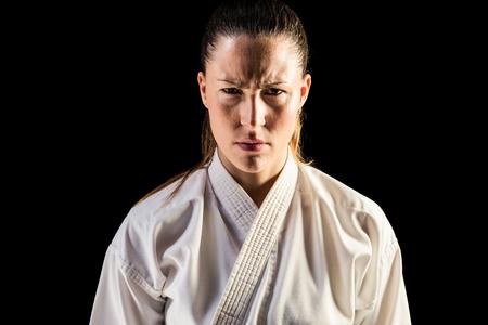 female fighter: Female fighter posing black background