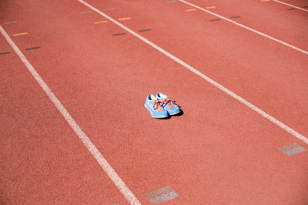 athleticism: Sport shoes on running track in stadium Stock Photo