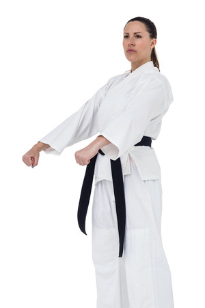 female fighter: Female fighter performing karate stance on white background