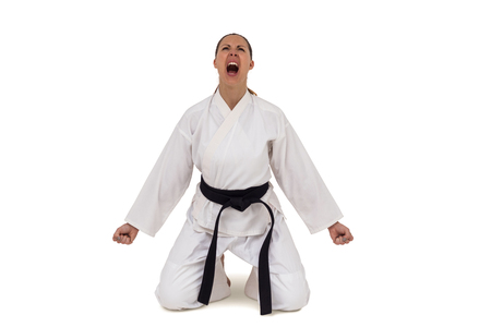 karateka: Female fighter posing after victory on white background