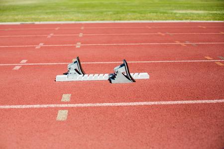 starting block: Starting block on a running track in stadium