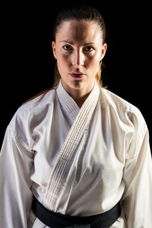 female fighter: Portrait of female fighter on black background
