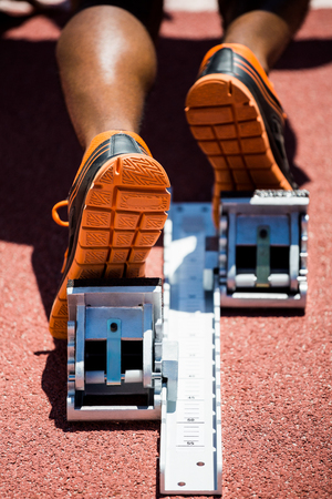 starting block: Close-up of feet of an athlete on a starting block about to run Stock Photo