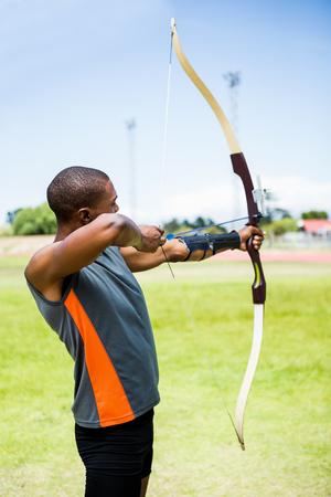 practicing: Athlete practicing archery in stadium