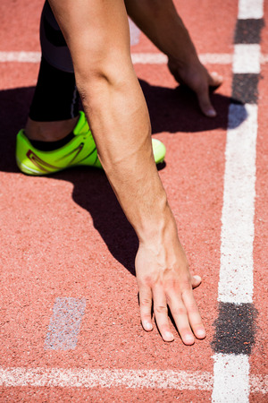 starting block: Athletes hands on a starting block  about to run