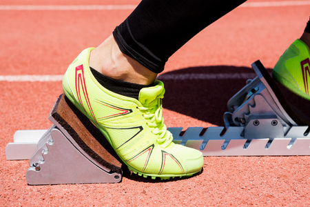 starting block: Close-up of athletes hands on a starting block  about to run Stock Photo