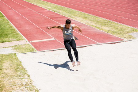 long jump: Athlete performing a long jump during a competition