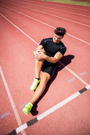 athleticism: Athlete warming up on the running track on a sunny day Stock Photo