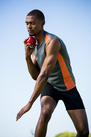 put: Determined athlete about to throw shot put ball