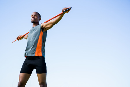 athleticism: Athlete carrying javelin on his shoulder and standing in stadium