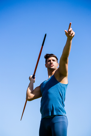javelin: Determined athlete about to throw a javelin in the stadium