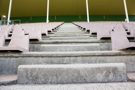 athleticism: Empty row of seats and steps in stadium