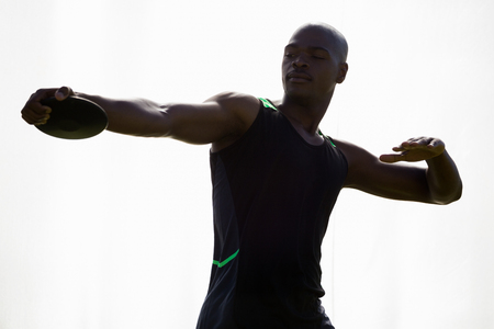 discus: Athlete about to throw a discus in stadium
