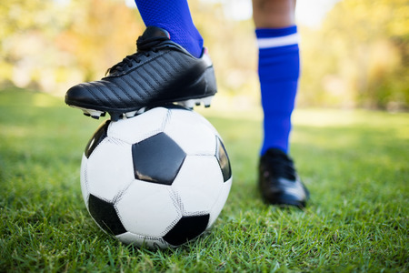 football boots: Close up view of balloon under football boots in park