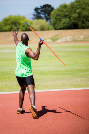 javelin: Athlete about to throw a javelin in the stadium