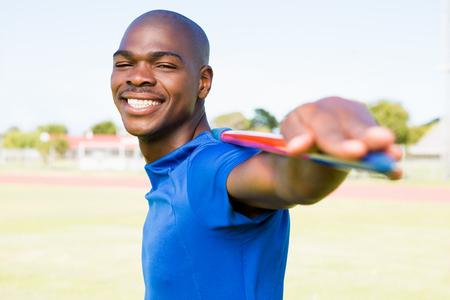 javelin: Portrait of athlete standing with javelin in stadium Stock Photo