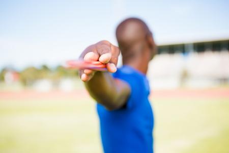 javelin: Athlete standing with javelin in stadium