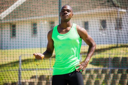 hammer throw: Portrait of athlete holding hammer throw in stadium