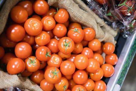 high angle: high angle view of tomatoes in shelf at supermarket
