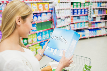 over the shoulder: Over shoulder view of woman looking product at supermarket Stock Photo