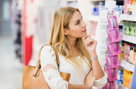concentrated: Portrait of concentrated woman in supermarket Stock Photo