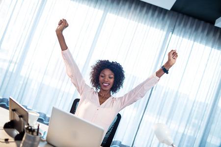 succeeding: Businesswoman succeeding at office Stock Photo