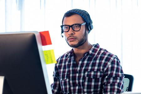 cool guy: Portrait of man wearing headset in studio