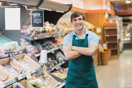 grocer: Portrait of man grocer smiling with his arms crossed