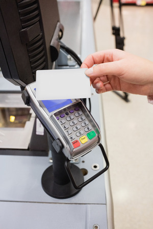 wireless terminals: Close up of payment by credit card without contact