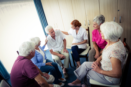 sheltered accommodation: Seniors interacting with nurse in the retirement house