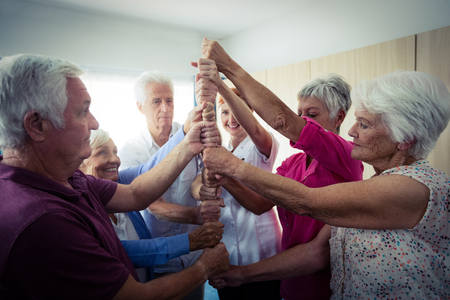 sheltered accommodation: Group of seniors playing in the retirement house