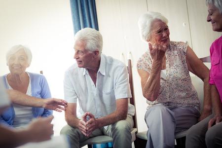interacting: Seniors interacting in the retirement house Stock Photo