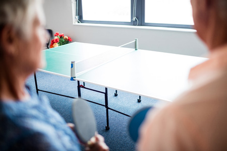 sheltered accommodation: Two seniors front of a table in the retirement house Stock Photo