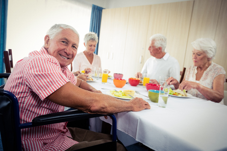 sheltered accommodation: Pensioners at lunch in the retirement house