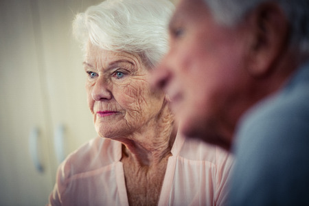 interacting: Pensioners interacting in retirement house Stock Photo