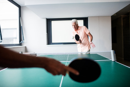 sheltered accommodation: Senior playing table tennis in the retirement house Stock Photo