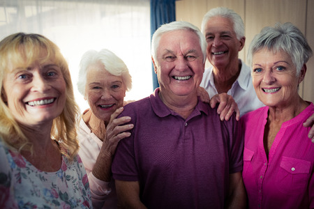 sheltered accommodation: Group of seniors doing a selfie with a smartphone in the retirement house