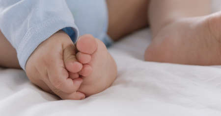 baby's feet: Focus on babys feet on a bed at home