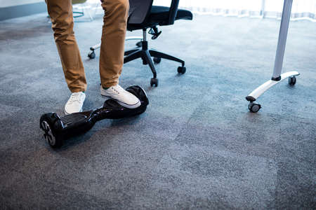 electronic balance: Man using a smart balance wheel  in the office