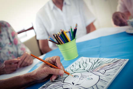 sheltered accommodation: Close up of hand colouring in the retirement house