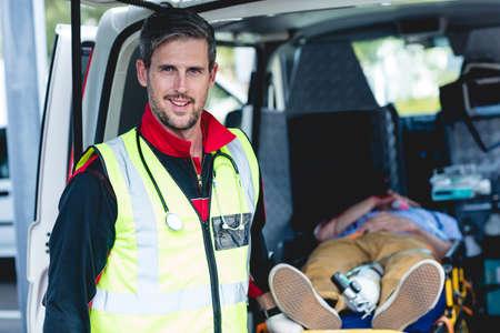 hospital trolley: Portrait of ambulance man front of ambulance car