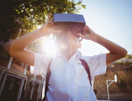 virtual school: School boy in virtual reality glasses in campus at school