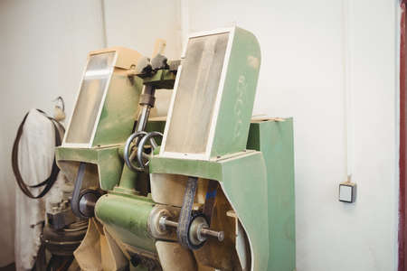 brogue: Machine repairing a shoe in a workshop