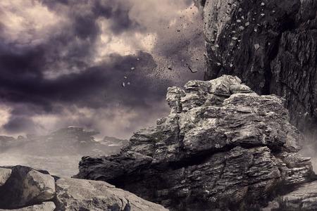 crashing: Rock crashing down from cliff