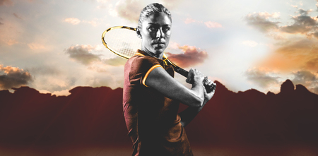 composite image: Tennis player playing tennis with a racket against composite image of landscape
