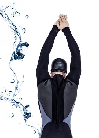 bubbling: Rear view of swimmer in wetsuit while diving against water bubbling on white surface